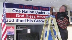 """— Bless America"": Teacher Ordered to Take Down Banners"