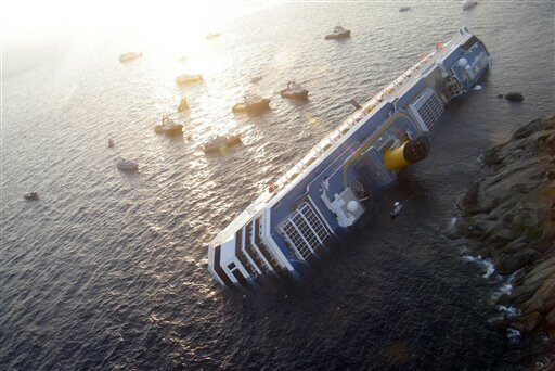 hull of the Eastern Star carry the body of a victim of the cruise ship ...