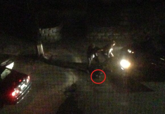 The shootout between the cops and the Bombing Suspects. The red circle is believed to be a pressure cooker bomb.