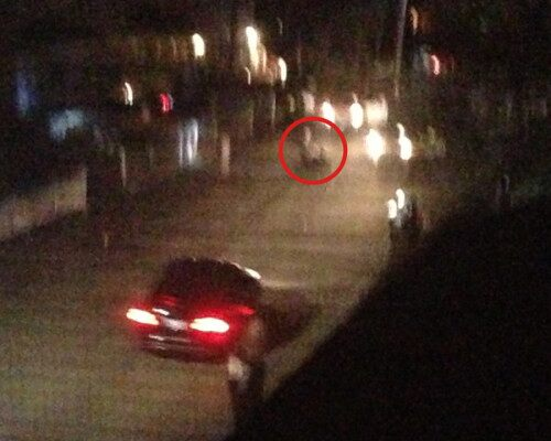The Boston Bomber Suspect apparently driving toward the cops and his older brother (who is circled)