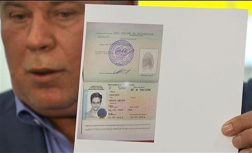 AP photo: Russian lawyer Anatoly Kucherena with Snowden document