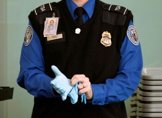 TSA-Agent-Putting-On-Search-Glove