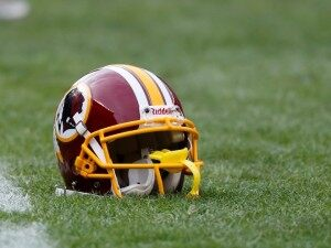 Washington Redskins helmet on the field before an NFL football game against the Cleveland Browns in Cleveland, Sunday, Dec. 16, 2012. (AP Photo/Rick Osentoski) ORG XMIT: OHMD