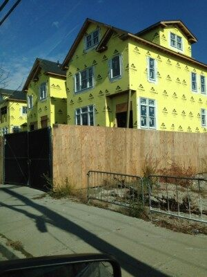Houses under construction wearing yellow Rockaway