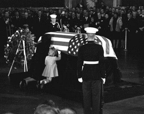 (AP Photo) November 24, 1963 Jacqueline and Caroline kiss casket in the Capitol rotunda