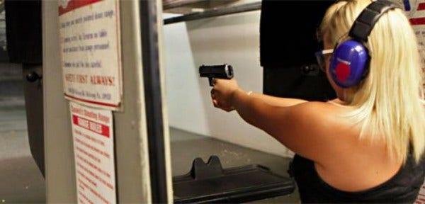 636-women-gun