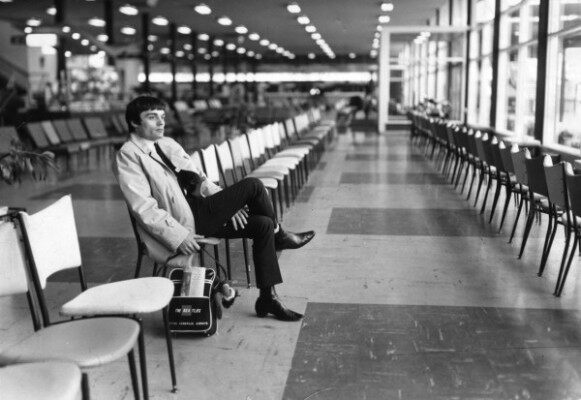 #13-14 Nicol at the airport alone. No longer a Beatle