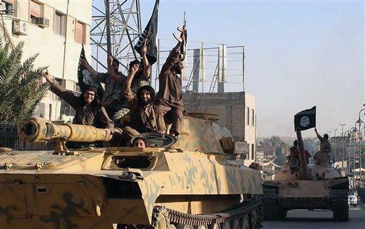 (AP Photo/Raqqa Media Center of the Islamic State group, File)