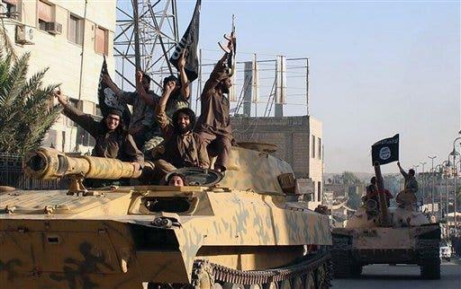 (AP Photo/Raqqa Media Center, File)