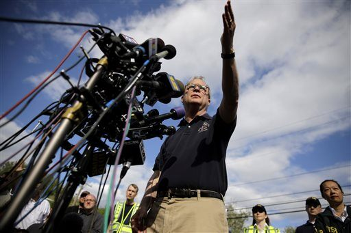 National Transportation Safety Board member Robert Sumwalt calls on a reporter for a question during a news conference near the scene of a deadly Amtrak train wreck, Wednesday, May 13, 2015, in Philadelphia. Sumwalt said Wednesday that the train was traveling at 106 mph when the engineer hit the brakes Tuesday night.  (AP Photo/Matt Slocum)