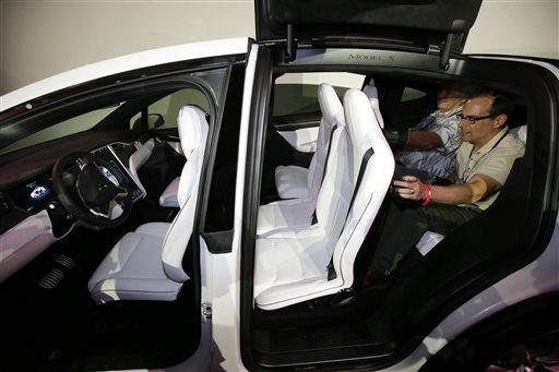 tesla unveils new model x suv news. Black Bedroom Furniture Sets. Home Design Ideas