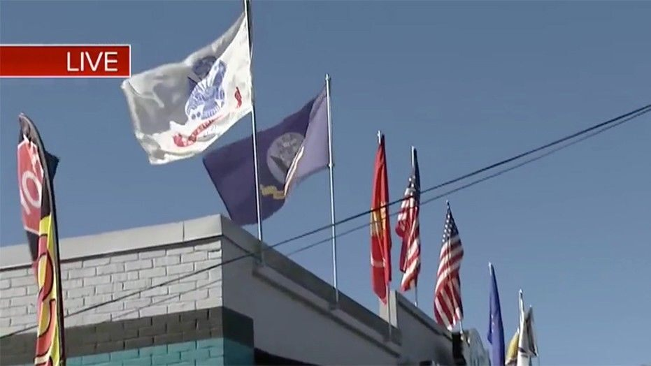 Florida business claims citation for flying military flags